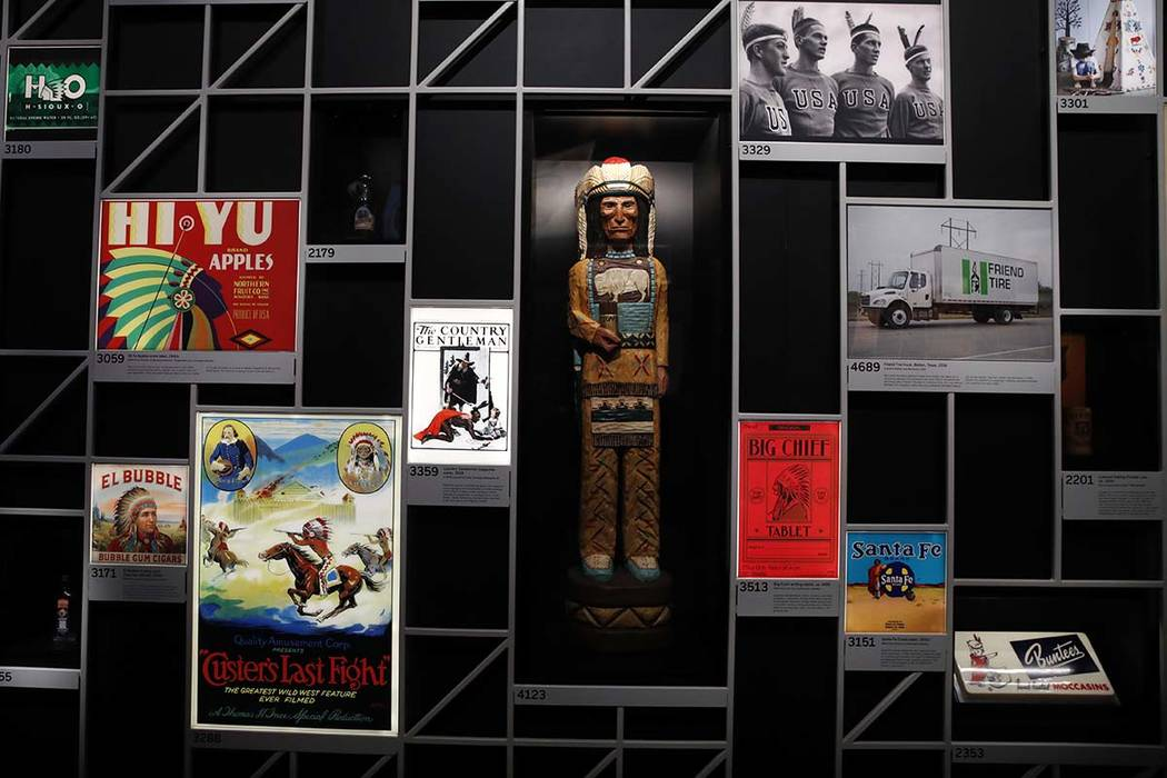 """Objects using imagery of Native Americans are on display at the """"Americans"""" exhibit at the Smithsonian's National Museum of the American Indian, Friday, Feb. 9, 2018, in Washington, D.C.  (Jacquel ..."""