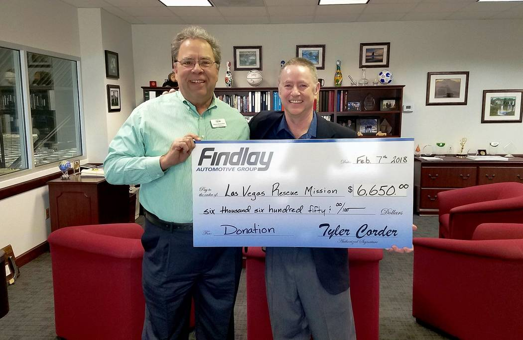 Findlay Automotive Findlay Automotive Group CFO Tyler Corder, right, presents a check to Harry Hinderliter, president and CEO of Las Vegas Rescue Mission.