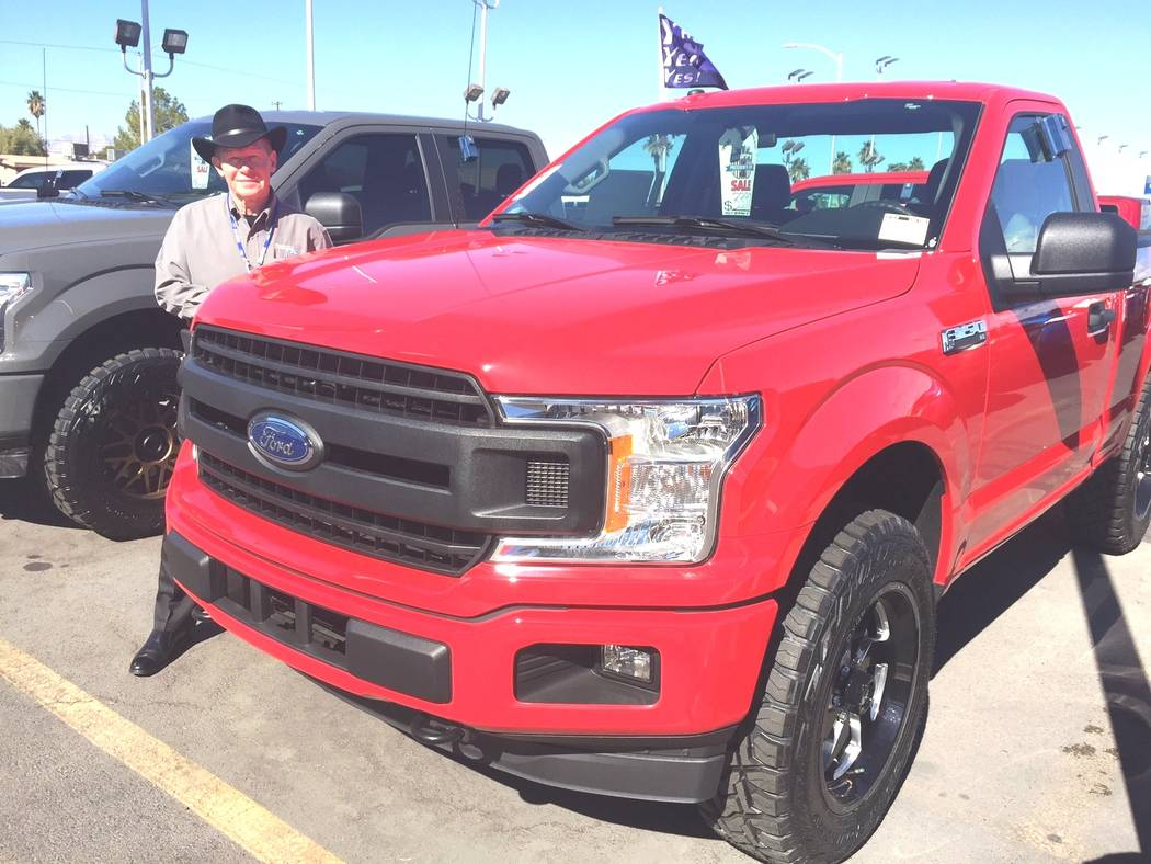 Friendly Ford Larry Davis, who was named Friendly Ford's Sales Consultant of the Year for 2017, is seen among 2018 F-150s.