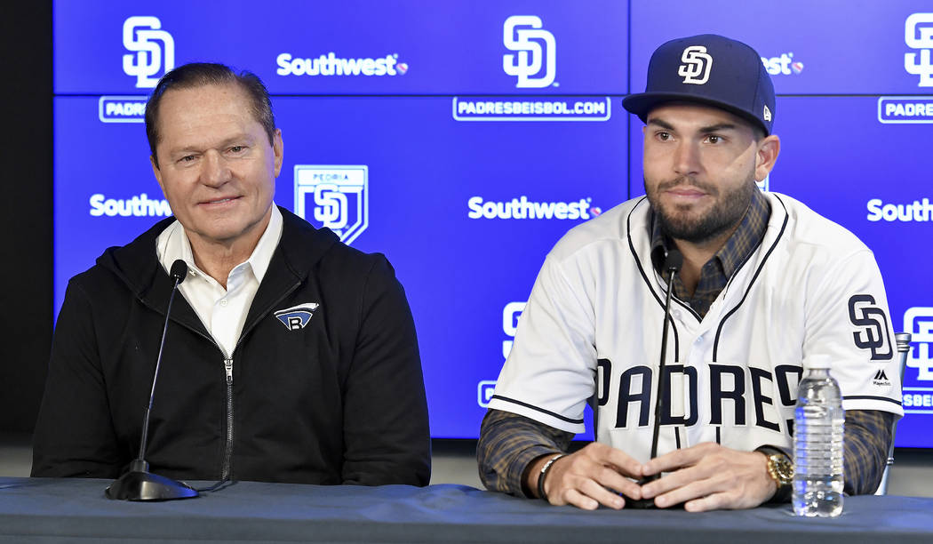 San Diego Padres baseball player Eric Hosmer, right, answers questions during an introductory press conference in Peoria, Ariz., Tuesday, Feb. 20, 2018. Hosmer and the Padres finalized their $144  ...