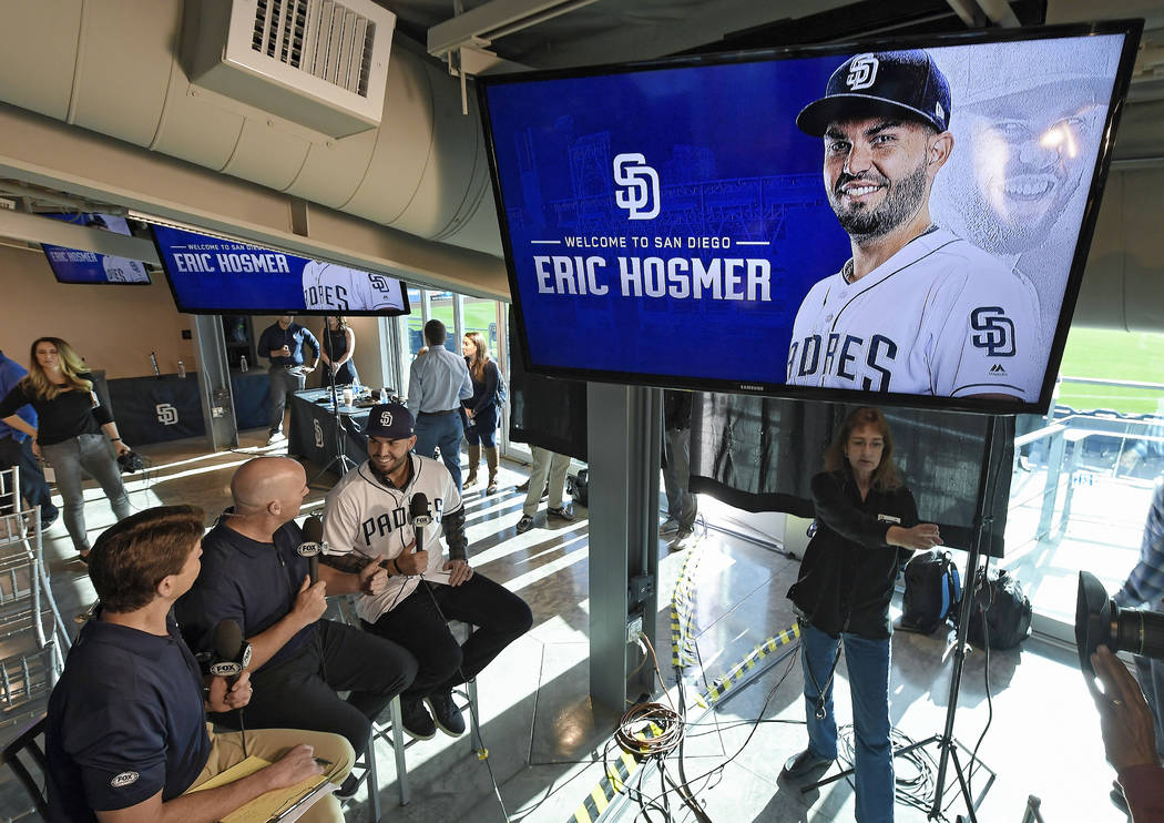 San Diego Padres baseball player Eric Hosmer is interviewed after an introductory press conference in Peoria, Ariz., Tuesday, Feb. 20, 2018. Hosmer and the San Diego Padres finalized their $144 mi ...