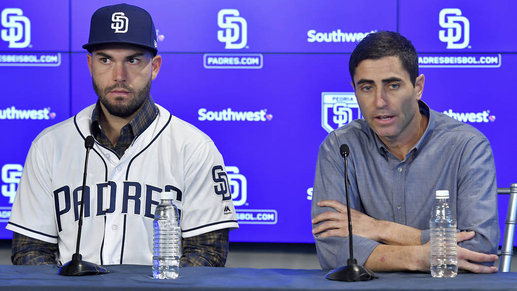 San Diego Padres baseball player Eric Hosmer, left, listens as Padres general manager A.J. Preller speaks during an introductory press conference in Peoria, Ariz., Tuesday, Feb. 20, 2018. Hosmer a ...