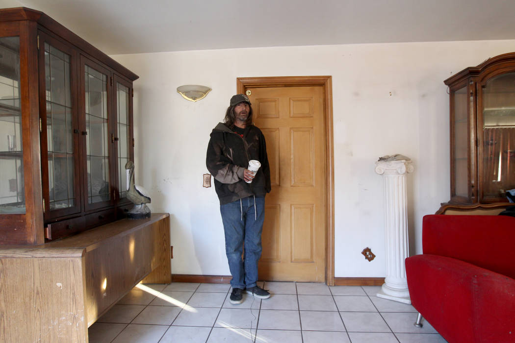 Andy Impereti emerges from his room at 724 N. 9th St. in downtown Las Vegas Friday, Jan. 26, 2018. The home was part of a Nevada state program that pays providers to house and feed mentally ill cl ...