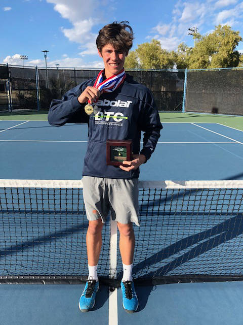 Michael Andre shows off medals he won at the USTA Boys 16 National Level 2 tournament in Long Beach, California, on Feb. 12. (Saad Ashraf)