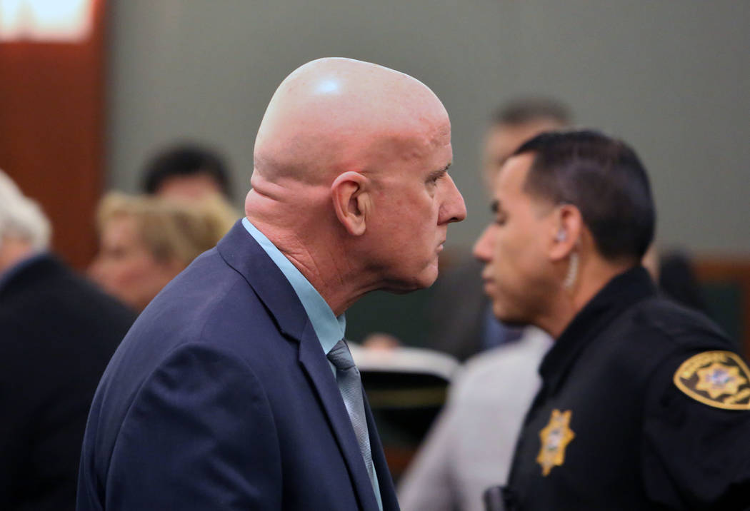 Las Vegas police Lt. James Melton leaves the courtroom at the Regional Justice Center on Wednesday, Feb. 21, 2018, in Las Vegas. Melton faces 14 felony counts, including theft, grand larceny auto, ...