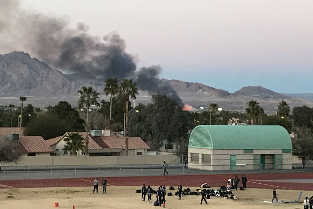 Smoke from a fire at Wetlands Park is seen from Green Valley High School on Tuesday, Feb. 20, 2018. (Sam Gordon/Las Vegas Review-Journal)