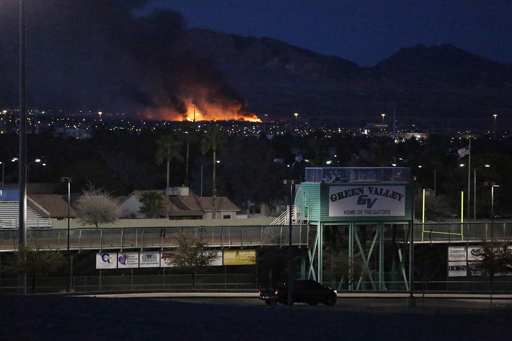 A fire as seen from Green Valley High School in Henderson engulfs a section of Clark County Wetlands Park on Tuesday, February 20, 2018. Michael Quine/Las Vegas Review-Journal @Vegas88s