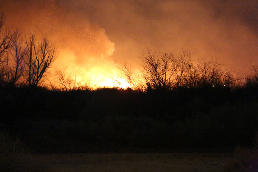 A fire engulfs a section of Clark County Wetlands Park on Tuesday, February 20, 2018. Michael Quine/Las Vegas Review-Journal @Vegas88s