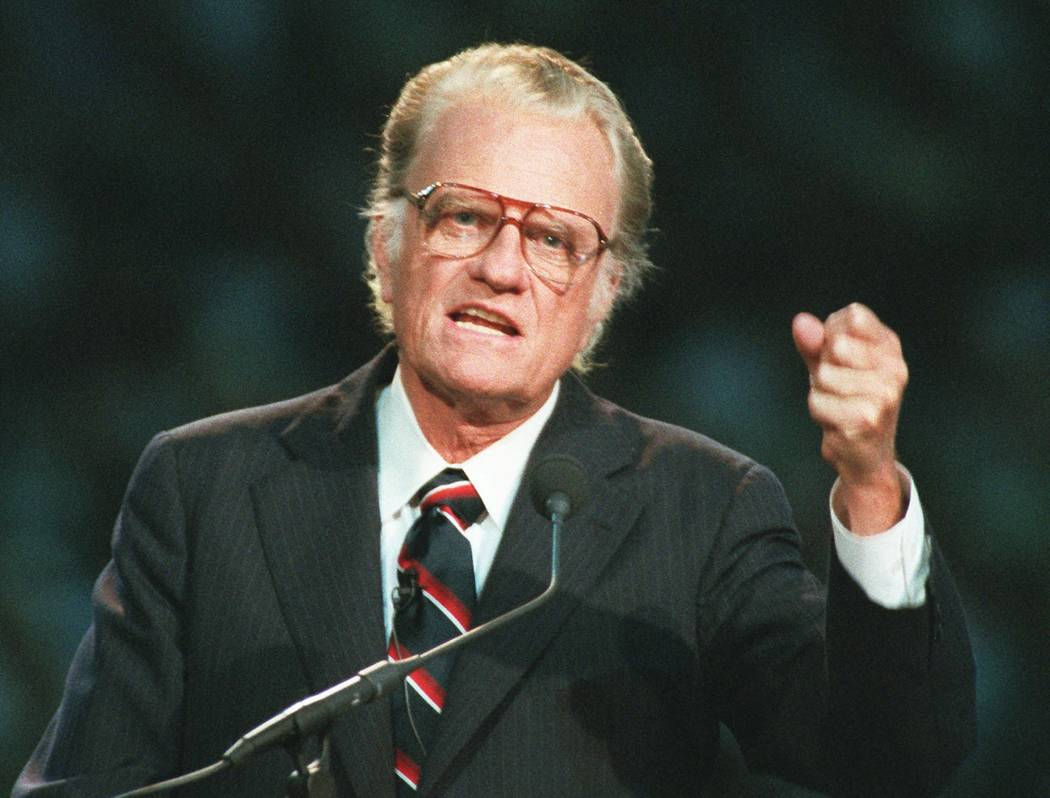In this Oct 26, 1994 file photo, Evangelist Billy Graham begins his sermon in Atlanta's Georgia Dome. Graham, who transformed American religious life through his preaching and activism, becoming a ...