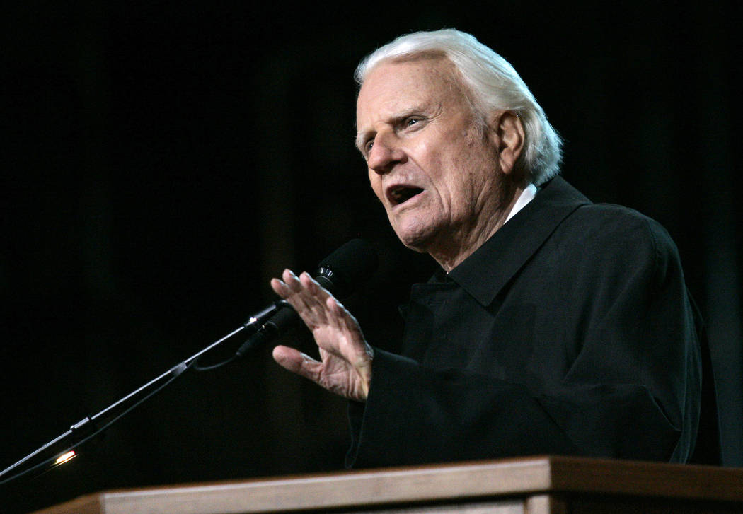 Billy Graham speaks to a congregation during the opening night of the Billy Graham Crusade at the Rose Bowl in Pasadena, Thursday, Nov. 18, 2004. (AP Photo/Danny Moloshok)