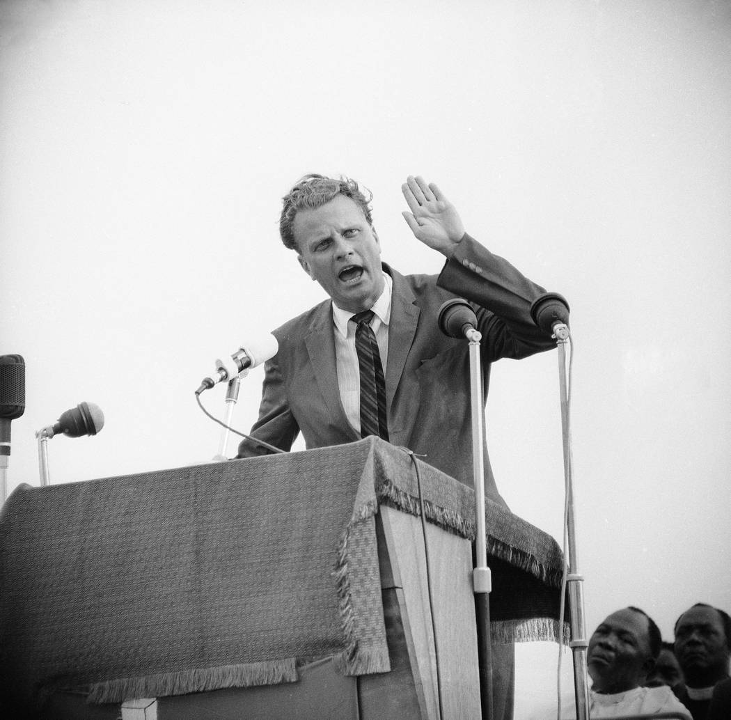 Evangelist Billy Graham at his first meeting at the Sports Stadium in Accra, Ghana, Jan. 24, 1960. (AP Photo/Royale)