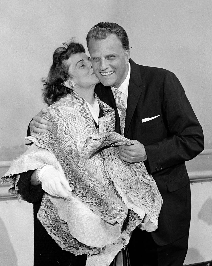 Evangelist Billy Graham gets a kiss from his wife Ruth, on arrival in New York on the ocean liner Queen Elizabeth, in this March 29, 1960 file photo, after a two and a half month tour of Africa an ...