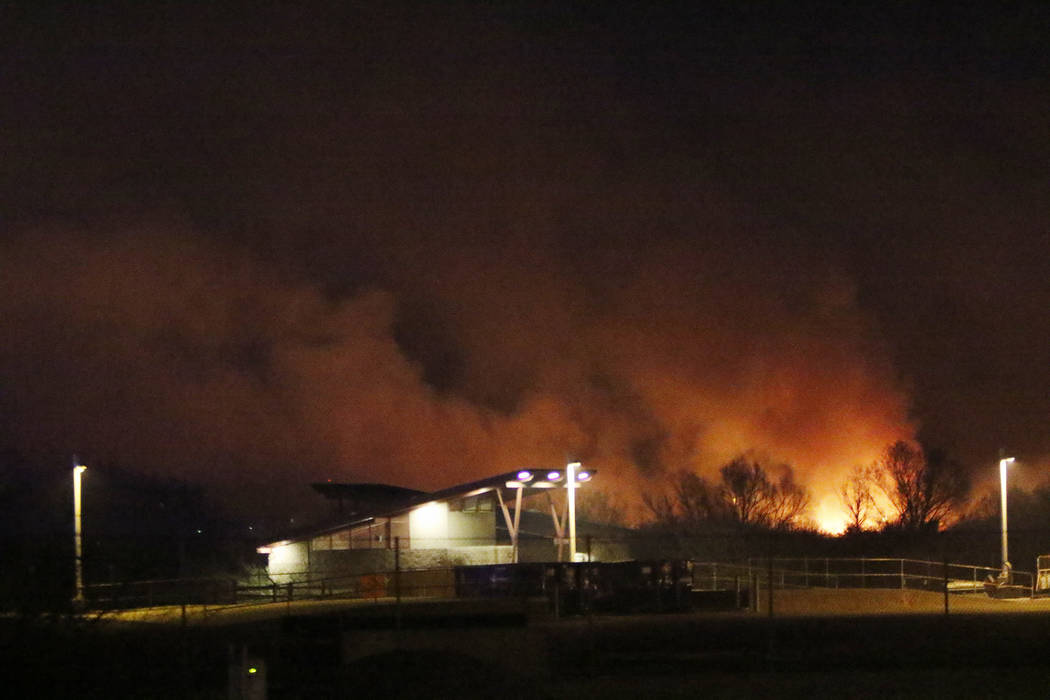 A brush fire at Clark County Wetlands Park produced large plumes of smoke visible throughout much of the valley Tuesday, Feb. 20, 2018, in Henderson. Rachel Aston Las Vegas Review-Journal @rookie__rae
