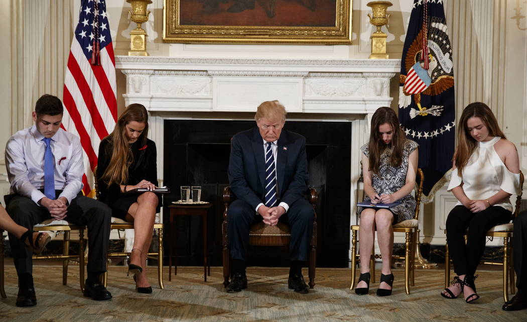From left, Marjory Stoneman Douglas High School student Jonathan Blank, Julia Cordover, the student body president at Marjory Stoneman Douglas High School, President Donald Trump, Marjory Stoneman ...
