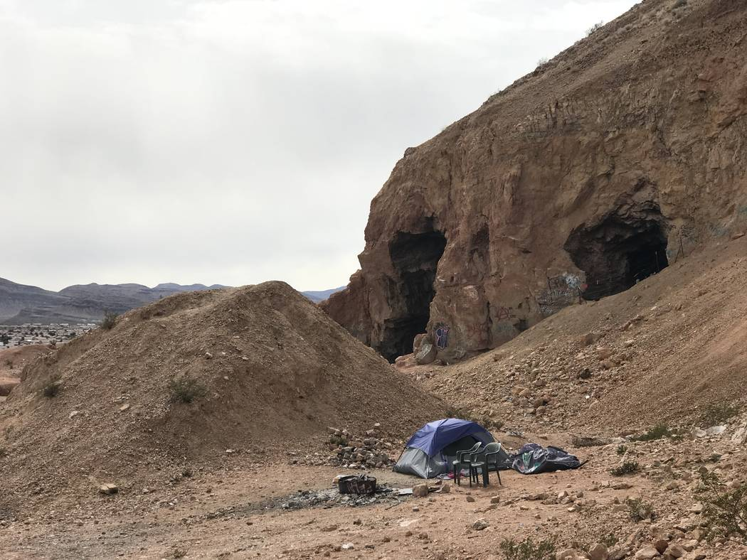 A squatter's tent sits near the opening of an abandoned gypsum mine near Fort Apache and Warm Springs roads on Wednesday, Feb. 21, 2018. (Henry Brean/Las Vegas Review-Journal)