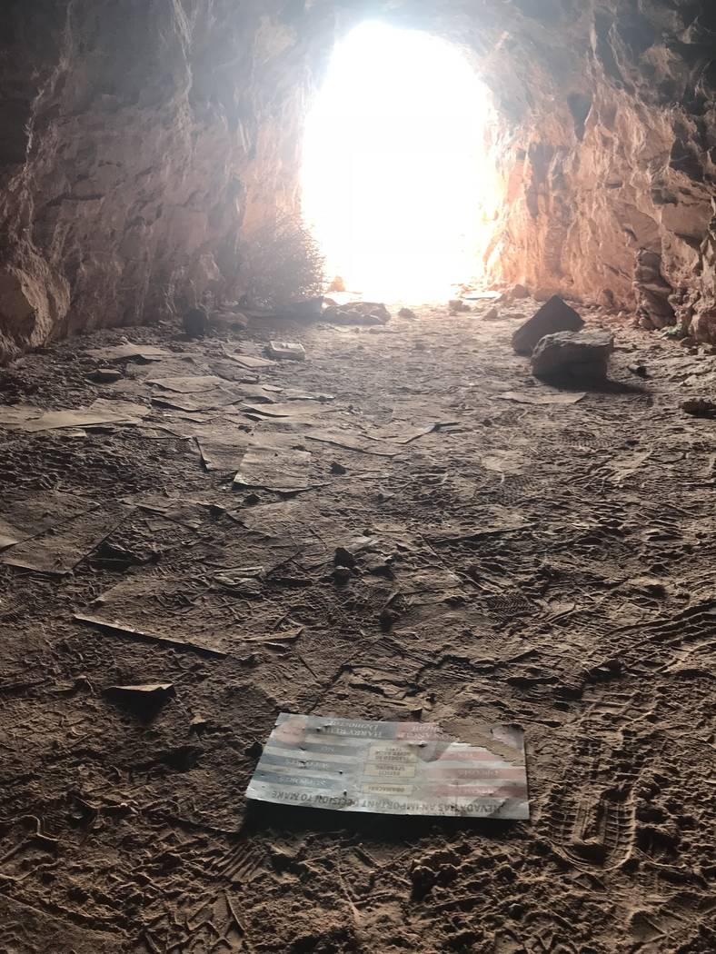 Campaign mailers from a 2010 senate race litter the floor of an abandoned mine shaft near Fort Apache and Warm Springs roads on Wednesday, Feb. 21, 2018. (Henry Brean/Las Vegas Review-Journal)