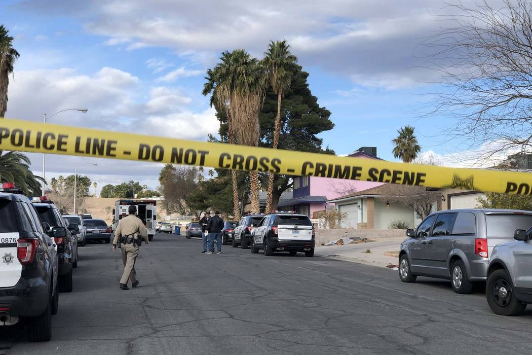 Las Vegas police investigate where a man was found shot to death at 4323 Del Santos Drive in east Las Vegas early Monday, Feb. 19, 2018. It was the second fatal shooting at that address since Dece ...