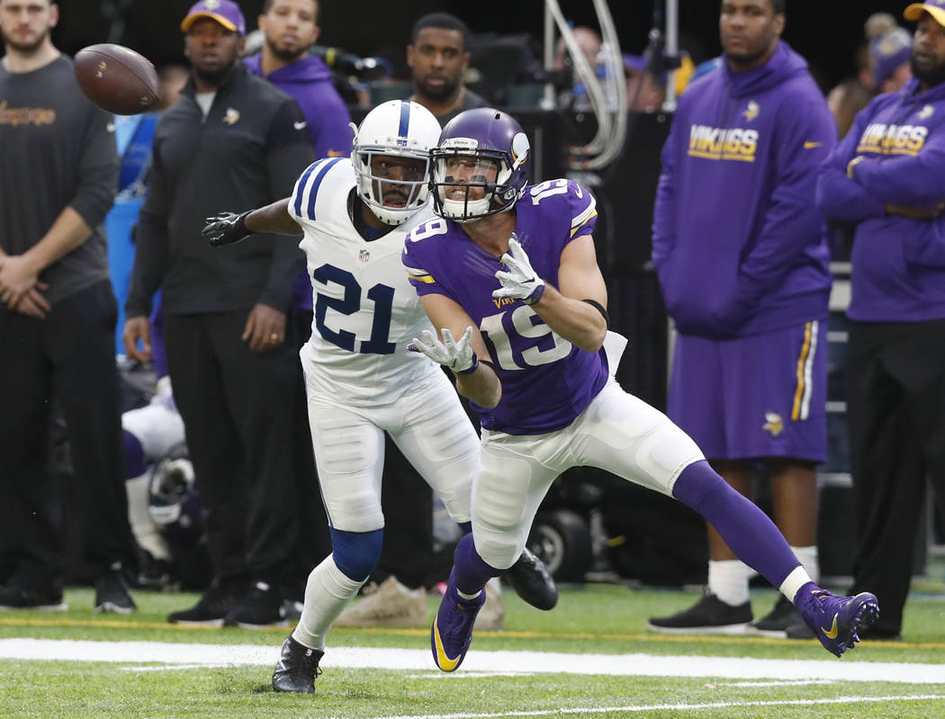 Minnesota Vikings wide receiver Adam Thielen (19) is unable to catch a pass as Indianapolis Colts cornerback Vontae Davis (21) defends during the second half of an NFL football game Sunday, Dec. 1 ...