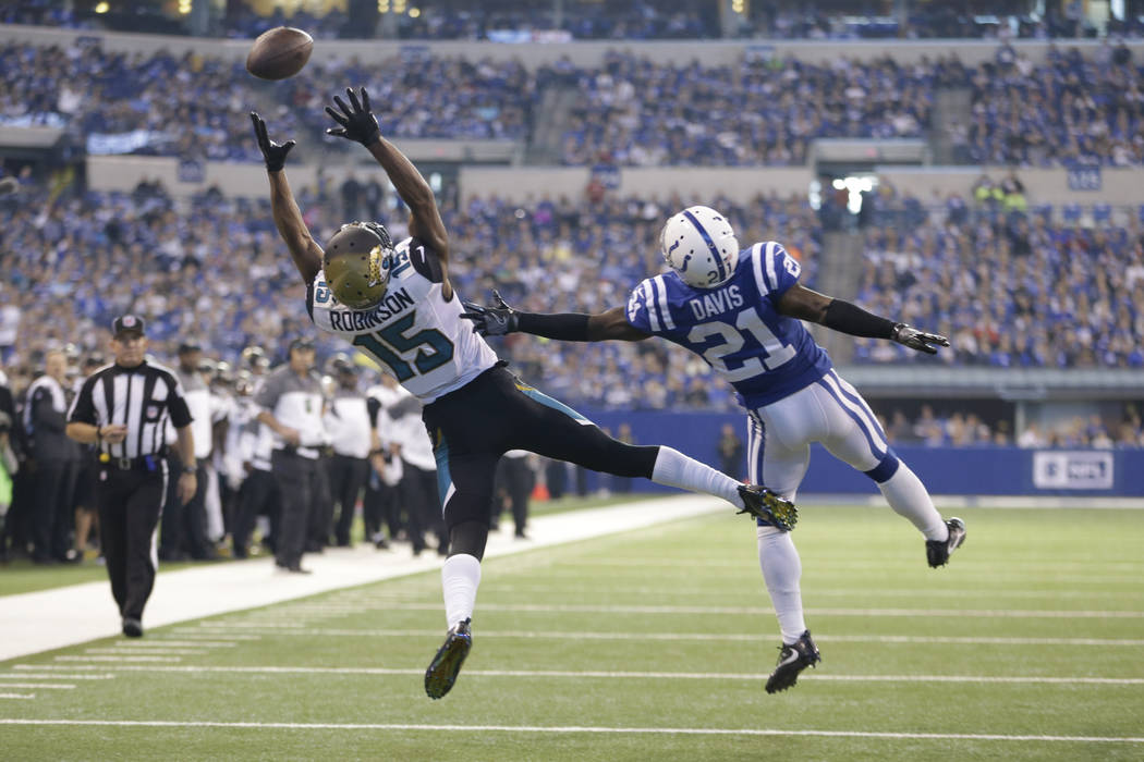 Indianapolis Colts cornerback Vontae Davis (21) defends Jacksonville Jaguars wide receiver Allen Robinson (15) as he can't make a catch during the second half of an NFL football game in Indianapol ...