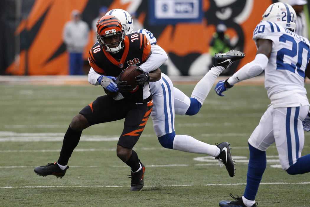 Cincinnati Bengals wide receiver A.J. Green (18) is tackled by Indianapolis Colts cornerback Vontae Davis (21) in the second half of an NFL football game, Sunday, Oct. 29, 2017, in Cincinnati. (AP ...