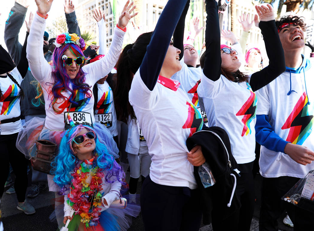 """Mary Staples and her 5-year-old daughter, Remie, attend the Color Run's """"Hero Tour"""" in downtown Las Vegas on Saturday, Feb. 24, 2018. The 5k benefits Three Square Food Bank, whic ..."""