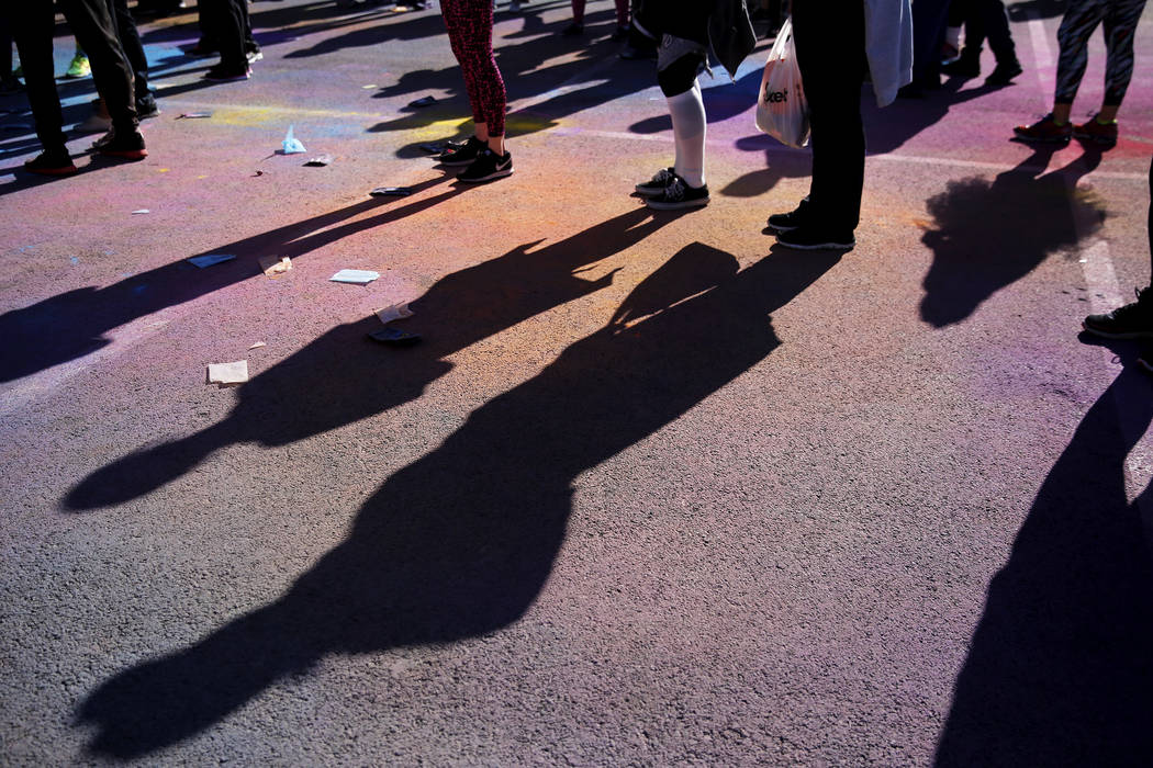 """Participants attend the Color Run's """"Hero Tour"""" in downtown Las Vegas on Saturday, Feb. 24, 2018. The 5k benefits Three Square Food Bank, which provides wholesome food to the hun ..."""