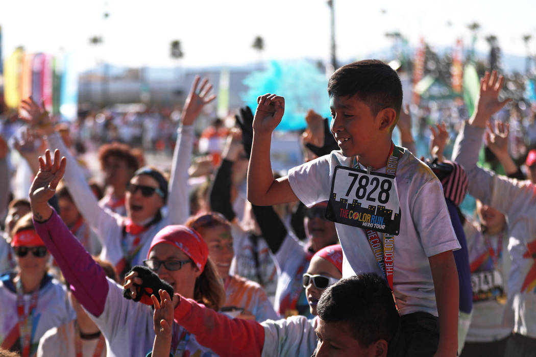 """Ivan Cordoba, 10, attends the Color Run's """"Hero Tour"""" in downtown Las Vegas on Saturday, Feb. 24, 2018. The 5k benefits Three Square Food Bank, which provides wholesome food to t ..."""
