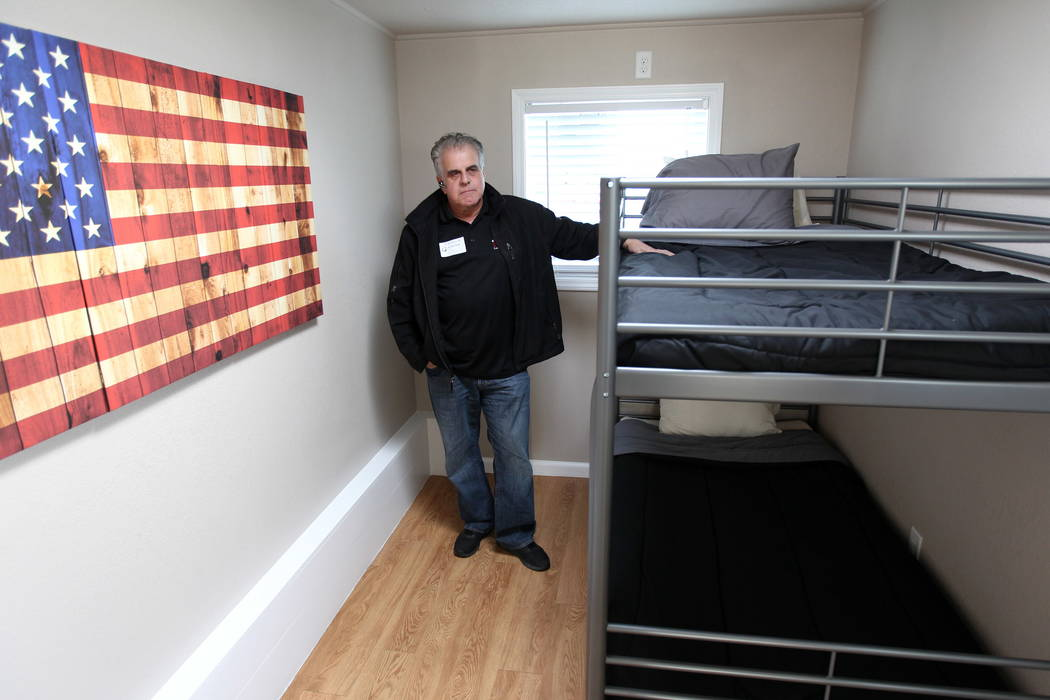 Arnold Stalk, founder of Veterans Village, shows a tiny home prototype made from a shipping container at Veterans Village Las Vegas Thursday, Feb. 22, 2018. K.M. Cannon Las Vegas Review-Journal @K ...