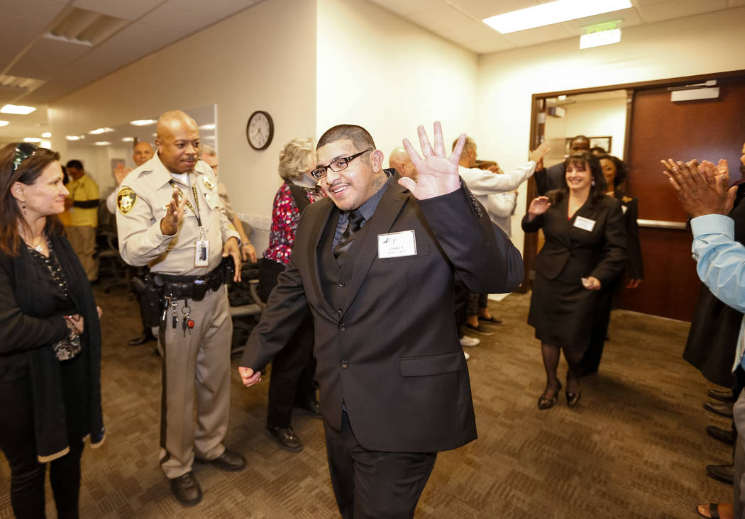 Former gang member Andrew Arevalo is greeted with high fives and applause before the Hope for Prisoners graduation ceremony at the Las Vegas Metropolitan Police Headquarters in Las Vegas on Friday ...