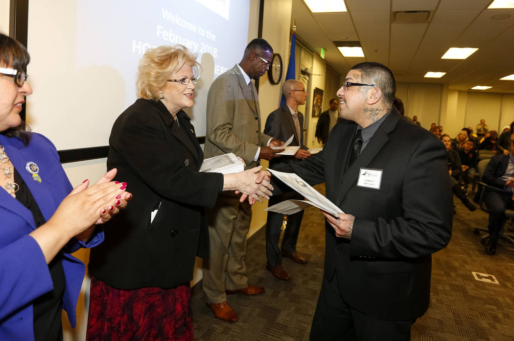 Las Vegas Mayor Carolyn Goodman, left, presents former gang member Andrew Arevalo with a certificate of recognition during the Hope for Prisoners graduation ceremony at the Las Vegas Metropolitan  ...