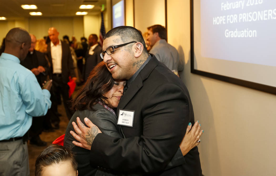 Former gang member Andrew Arevalo hugs his mother Anyela Arevalo following the Hope for Prisoners graduation ceremony at the Las Vegas Metropolitan Police Headquarters in Las Vegas on Friday, Feb. ...