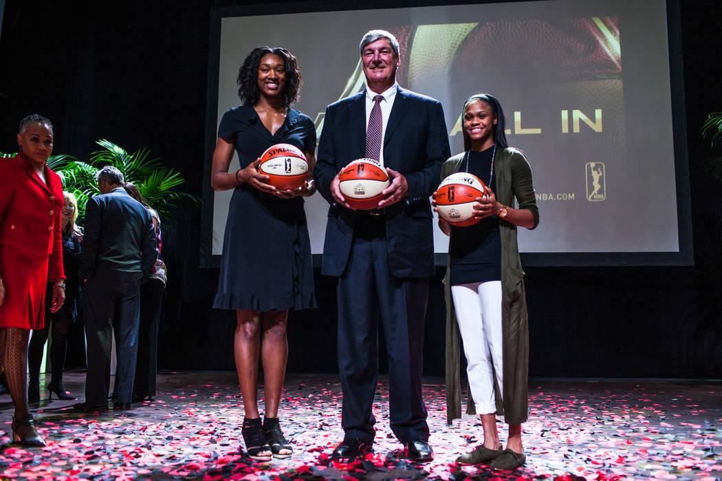 Las Vegas Aces' Kayla Janine Alexander, left, Las Vegas Aces head coach Bill Laimbeer, center, Las Vegas Aces' Moriah Jefferson, right, gather during the reveal of the Las Vegas Aces WNBA basketba ...