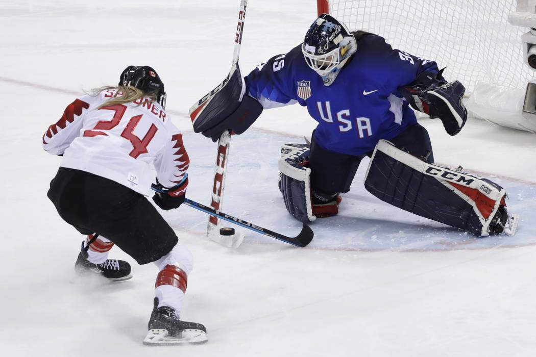 Goalie Maddie Rooney (35), of the United States, blocks a shot by Natalie Spooner (24), of Canada, in the penalty shootout during the women's gold medal hockey game at the 2018 Winter Olympics in  ...