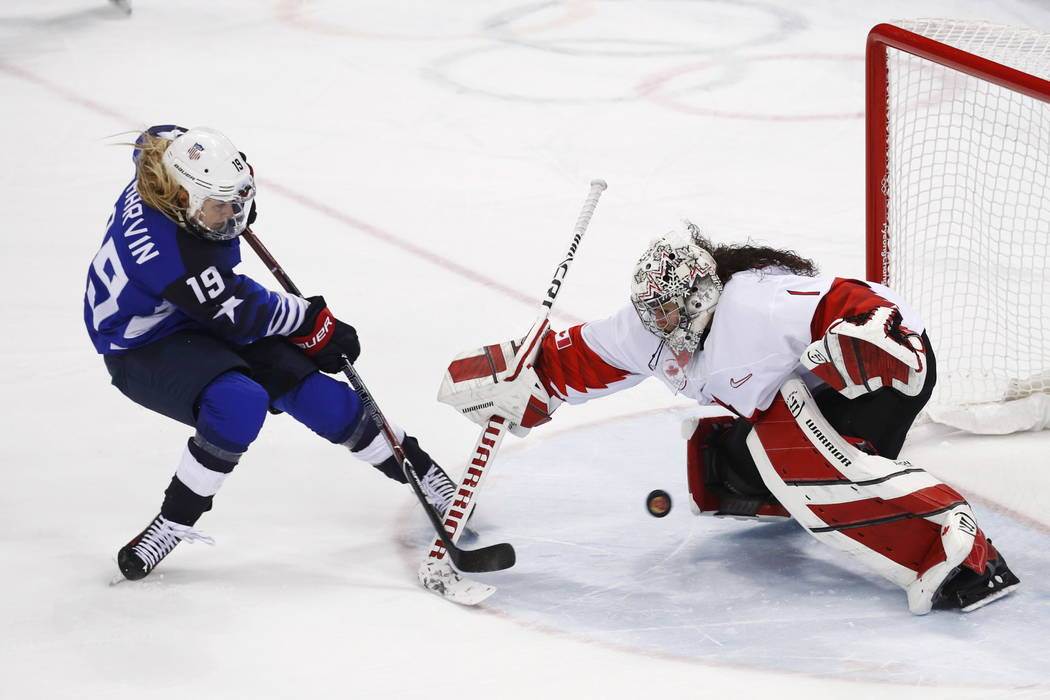 Gigi Marvin (19), of the United States, scores a goal against goalie Shannon Szabados (1), of Canada, in the penalty shootout during the women's gold medal hockey game at the 2018 Winter Olympics  ...