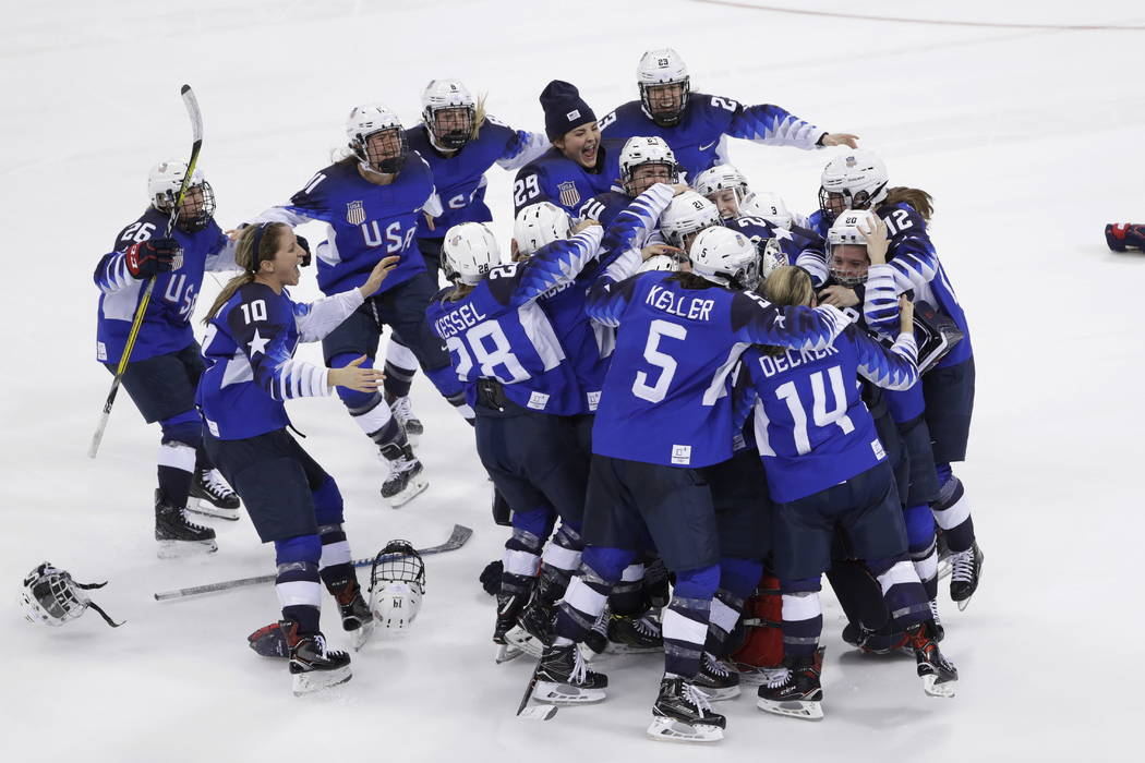 United States celebrates winning gold in the women's gold medal hockey game against Canada at the 2018 Winter Olympics in Gangneung, South Korea, Thursday, Feb. 22, 2018.(AP Photo/Matt Slocum)