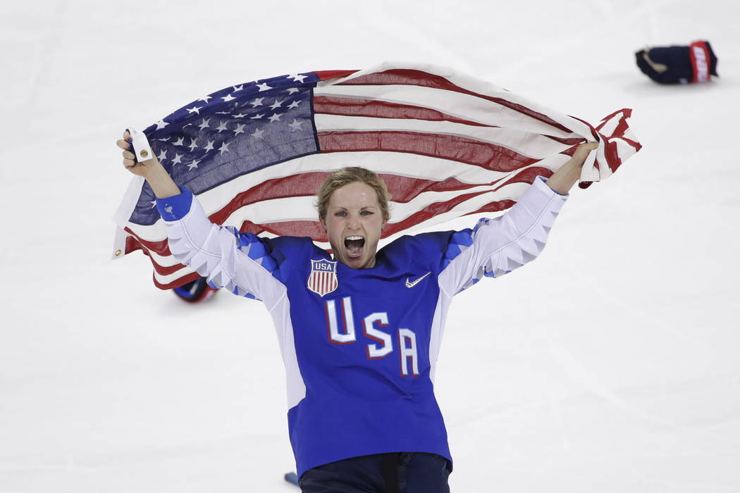 Jocelyne Lamoureux-Davidson (17), of the United States, celebrates after winning against Canada in the women's gold medal hockey game at the 2018 Winter Olympics in Gangneung, South Korea, Thursda ...