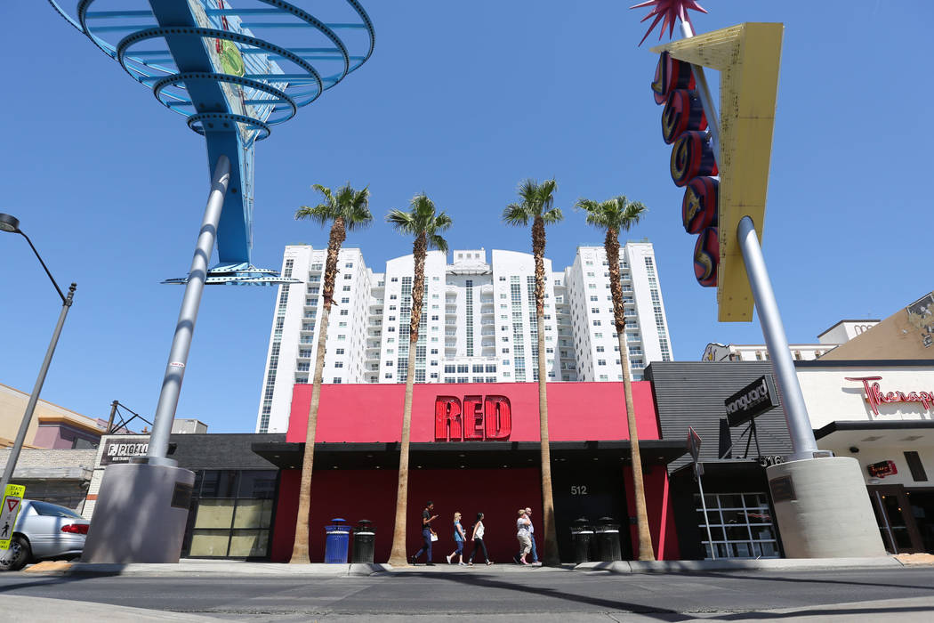 Pedestrians pass in front of Red on Fremont Street in Las Vegas in 2016. (Las Vegas Review-Journal)