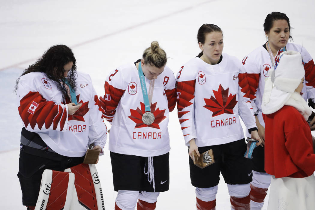 Jocelyne Larocque, (3), of Canada, holds her silver medal after losing to the United States in the women's gold medal hockey game at the 2018 Winter Olympics in Gangneung, South Korea, Thursday, F ...