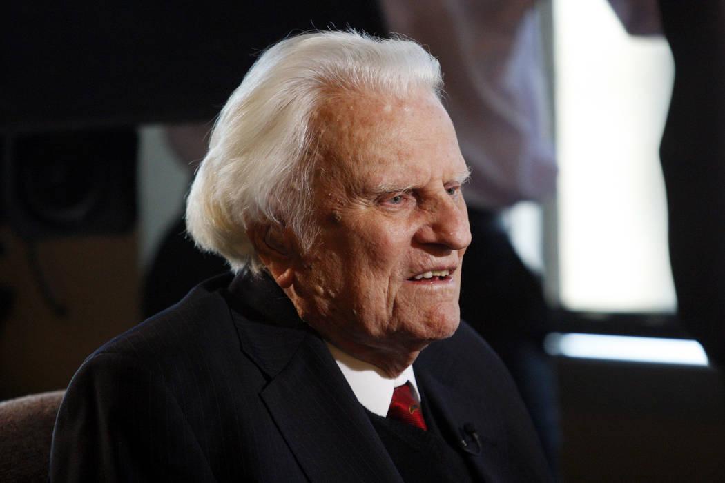 Evangelist Billy Graham, 92, speaks during an interview at the Billy Graham Evangelistic Association headquarters in Charlotte, N.C. on Dec. 20, 2010. (AP Photo/Nell Redmond, File)