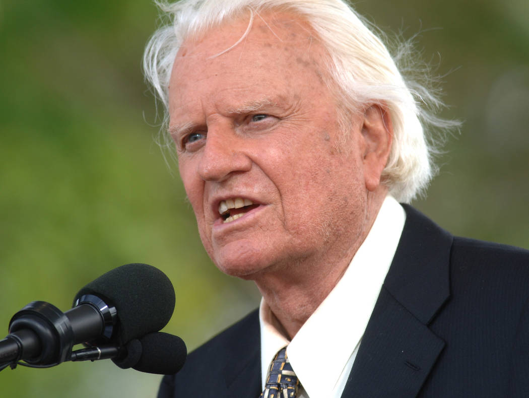 Rev. Billy Graham speaks on stage on the third and last day of his farewell American revival in the Queens borough of New York on June 26, 2005. (AP Photo/Henny Ray Abrams)