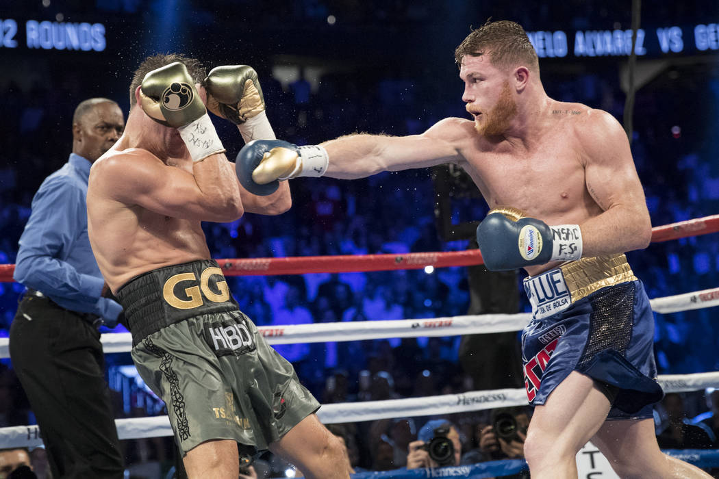 Gennady GGG Golovkin, left, battles Saul Canelo Alvarez in the WBC, WBA, IBF, RING middleweight title bout at T-Mobile Arena in Las Vegas, Saturday, Sept. 16, 2017. The fight ended in a split draw ...