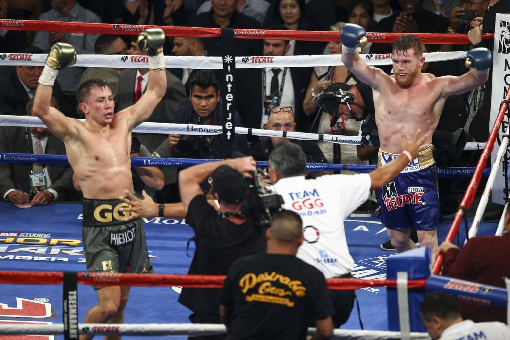 "Saul ""Canelo"" Alvarez, left, and Gennady ""GGG"" Golovkin at the end of their middleweight championship boxing match at T-Mobile Arena in Las Vegas on Saturday, Sept. 16, 2017. The fight ended in a  ..."