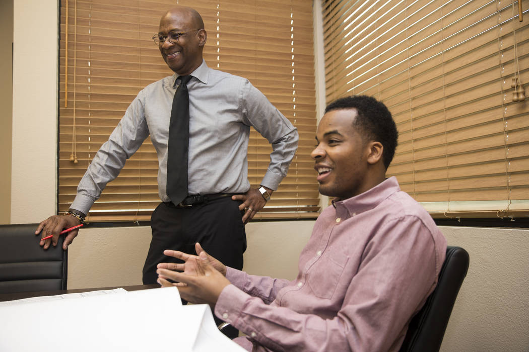 Melvin Green, left, principal at KME Architects, with intern Erick James, at the architect firm's Las Vegas office, Friday, Feb. 23, 2018. (Erik Verduzco/Las Vegas Review-Journal) @Erik_Verduzco