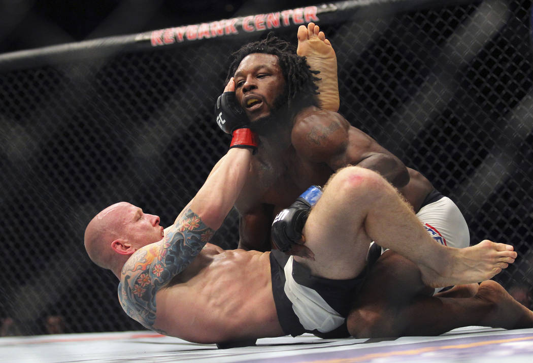 Josh Emmett, bottom, gets taken down by Desmond Green during a mixed martial arts bout at UFC 210, Saturday, April 8, 2017, in Buffalo, N.Y. (AP Photo/Jeffrey T. Barnes)
