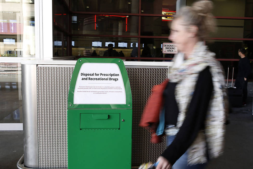 A passenger walks past a recently installed marijuana amnesty drop box at McCarran International Airport on Thursday, Feb.  22, 2018, in Las Vegas. Bizuayehu Tesfaye/Las Vegas Review-Journal @bizu ...