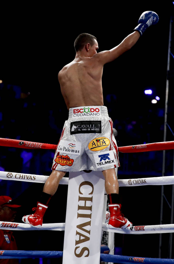 Juan Francisco Estrada, of Mexico, celebrates his win against Carlos Cuadras, of Mexico, during their WBC super flyweight title boxing match Saturday, Sept. 9, 2017, in Carson, Calif. (AP Photo/Ch ...