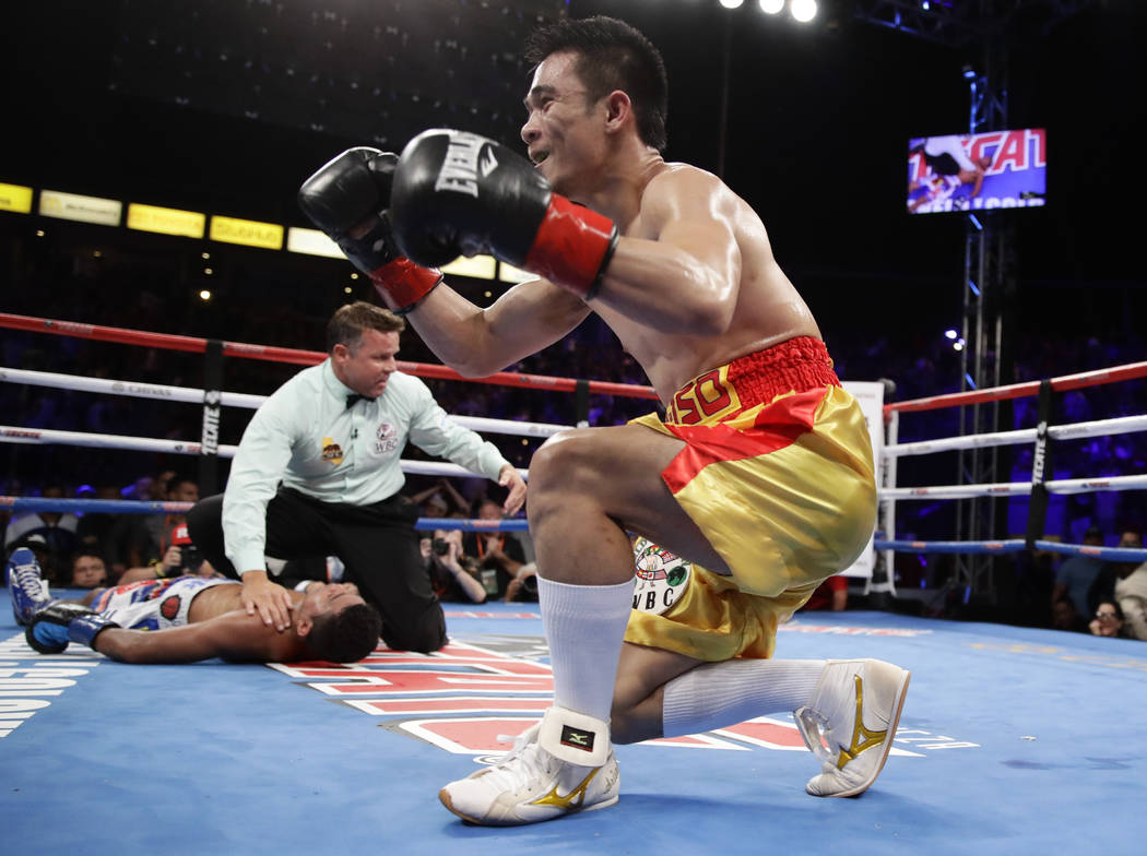Srisaket Sor Rungvisai, of Thailand, celebrates after knocking out Roman Gonzalez of Nicaragua, during the fourth round of their WBC super flyweight championship boxing match Saturday, Sept. 9, 20 ...