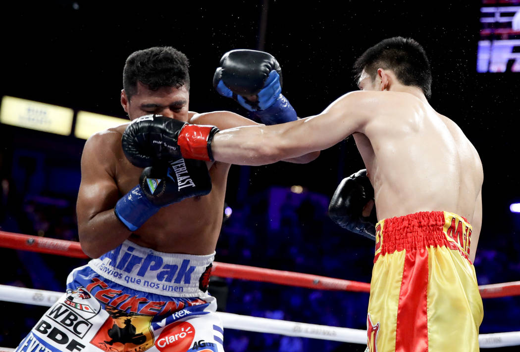 Srisaket Sor Rungvisai, right, of Thailand, hits Roman Gonzalez, of Nicaragua, during their WBC super flyweight championship boxing match Saturday, Sept. 9, 2017, in Carson, Calif. (AP Photo/Chris ...