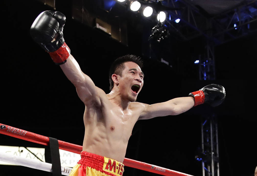 Srisaket Sor Rungvisai, of Thailand, celebrates after knocking out Roman Gonzalez, of Nicaragua, in the fourth round during their WBC super flyweight championship boxing match Saturday, Sept. 9, 2 ...