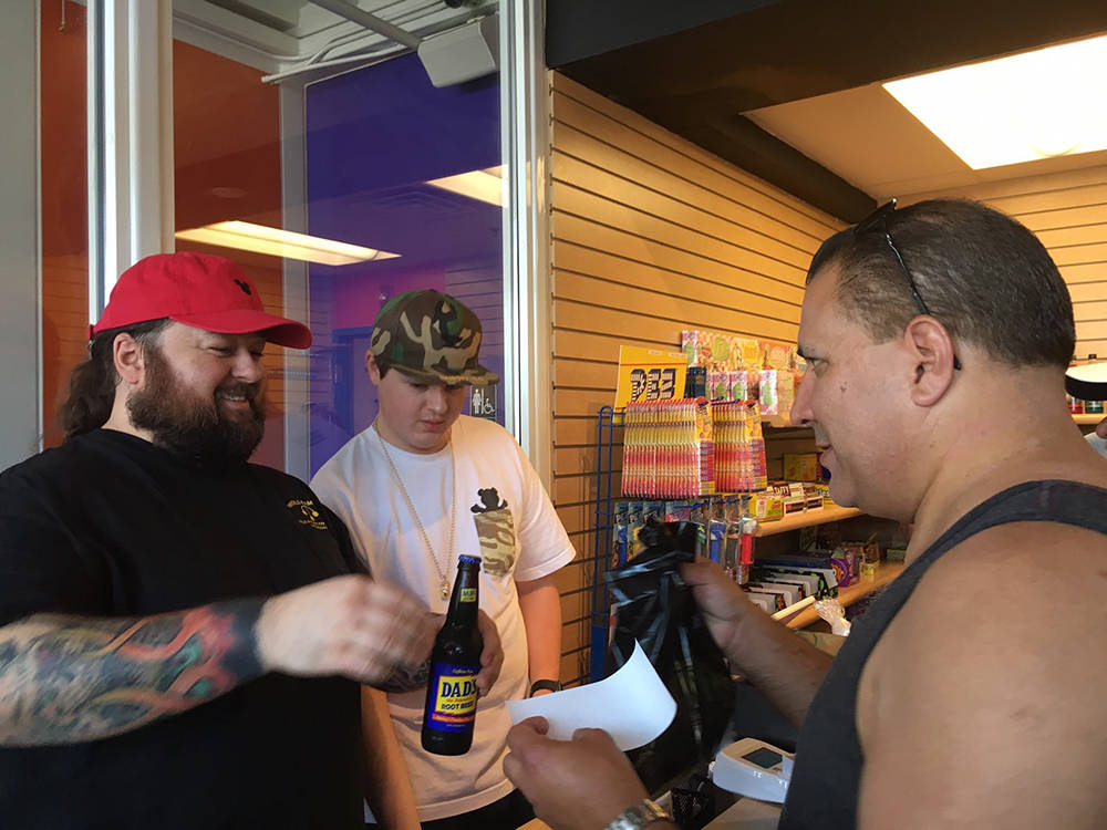 """Austin Russell, """"Chumlee"""" of """"Pawn Stars"""" fame talks to a customer at his new Chumlee's Candy on the Boulevard. (Courtesy)"""